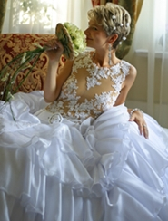 bride posing in wedding gown