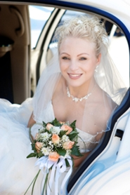 lovely young bride in back seat of limousine