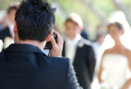 photographer taking photos of wedding party
