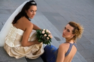 bride and maid of honor on church steps