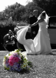 bride and groom dramatic photo with wedding bouquet