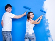 young couple painting their new home
