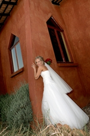 dramatic pose of bride outside of church