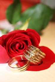 wedding rings on red rose
